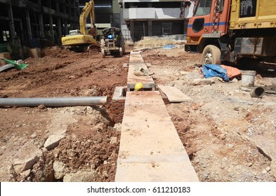 MALACCA, MALAYSIA -JANUARY 16, 2017: Underground utilities trenches under construction. Construction workers digging trenches to lay underground utility or services pipes at the construction site.