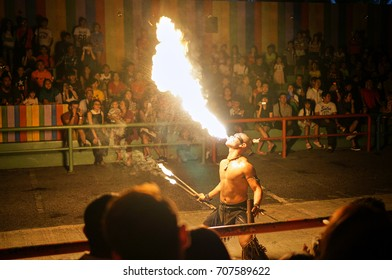 Malacca, Malaysia - January 31, 2017: A warrior performing the heady fire-blowing act in-front of spectators during the Red Indian Show at A'Famosa Resort Malacca. The crowds was amazed by the show.