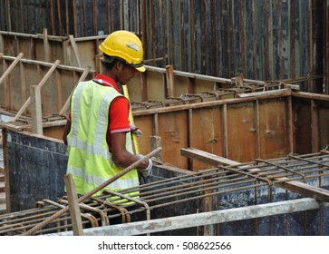 MALACCA, MALAYSIA -JULY 12, 2016: Construction workers fabricating timber form work at the construction site in Malacca, Malaysia. The form work was mainly made from timber and plywood.