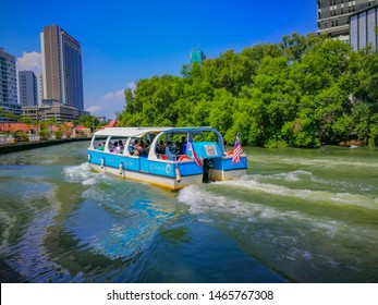 Malacca, Malaysia, July 2019: River Cruise Boat Cruising On Malacca River With City Skyline Background And Beautiful Blue Sky
