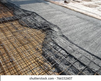 MALACCA, MALAYSIA -JULY 26, 2016: The wet concrete poured on a steel reinforcement bar to form strong floor slabs called reinforce concrete floor slab.