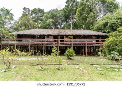 Malacca, Malaysia - June 25, 2018 : Traditional Iban Longhouse of Sarawak at the Mini Malaysia Park.