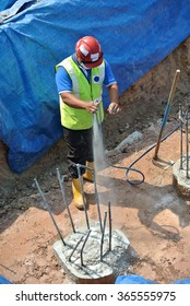 MALACCA, MALAYSIA â?? JUNE 26,  2015: Construction workers spraying the anti termite chemical treatment at the construction site