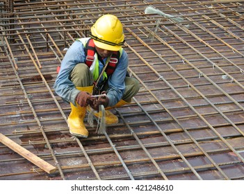 MALACCA, MALAYSIA -MAY 4, 2016: Construction workers fabricating floor slab reinforcement bar at the construction site in Malacca, Malaysia.