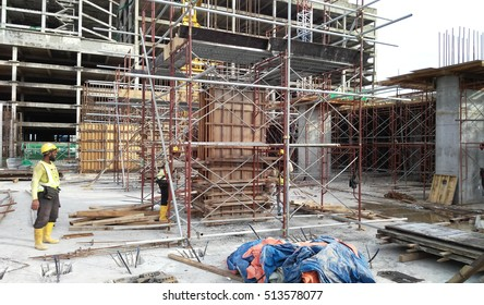 MALACCA, MALAYSIA -SEPTEMBER 19, 2016: Column timber form work and reinforcement bar at the construction site in Malacca, Malaysia. The structure supported by temporary wood support