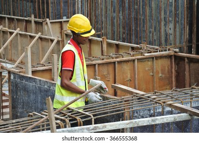 MALACCA, MALAYSIA � SEPTEMBER 22, 2015: Group of construction workers fabricating ground beam steel reinforcement bar at the construction site in Malacca