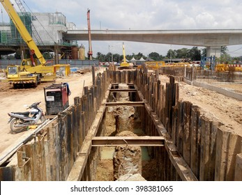 MALACCA, MALAYSIA -SEPTEMBER 25, 2015: Temporary steel sheet retaining wall using sheet pile cofferdam method holding outside soil from collaps into pile pits.