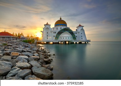 Malacca Straits Mosque ( Masjid Selat Melaka) during sunrise. Motion blur due to long exposure.