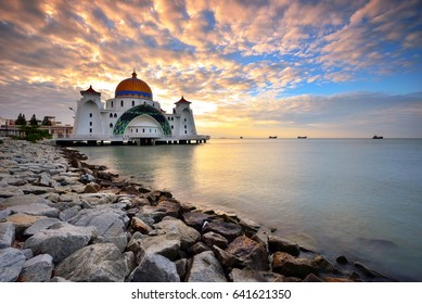 Malacca Straits Mosque ( Masjid Selat Melaka) with beautiful sunset background. It is a mosque located on the man-made Malacca Island near Malacca Town, Malaysia