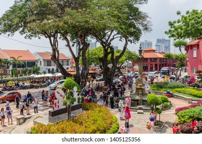 Malacca,Malaysia - April 21,2019: Scenic view of the Christ Church Malacca and Dutch Square,people can seen exploring around the it. It has been listed as UNESCO World Heritage Site since 7/7/2008.