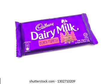 Malacca/Malaysia - February 3 2019 : Cadbury Dairy Milk Chocolate with jelly and biscuit on white background.