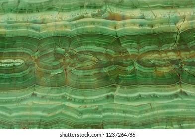 A malachite background. A malachite table.