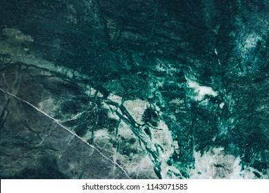 Malachite deep green natural marble texture, detailed close up green background in high resolution. Malachite green background of naturak marble stone