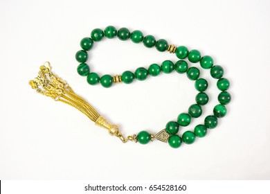 Malachite material prayer beads (rosary) on white background.