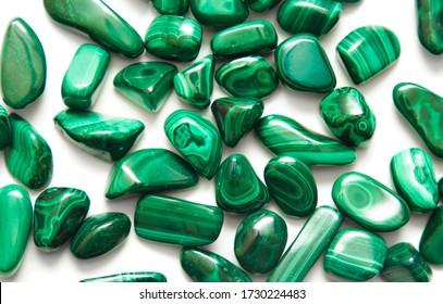Malachite (stone, mineral). Malachite spread on white background