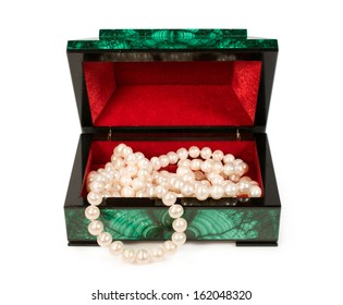 Malachite  treasure-box with a pearl necklace isolated on white