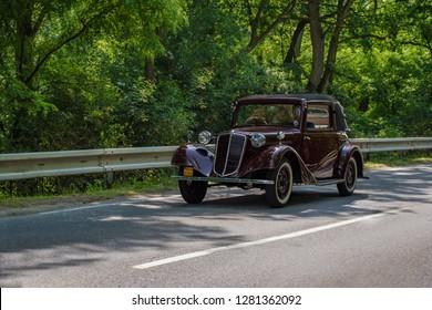 MALACKY, SLOVAKIA – JUNE 2 2018:  Tatra 57 B takes part in the run during the veteran car rally Kamenak 2018 at the Kamenny mlyn roadhouse
