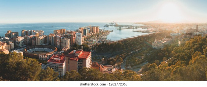 Malaga, Andalucia /Spain - 5th of January, 2019: Panorama of a Sunset in Malaga, Spain, where you can see the bullfighting ring, the port and the Cathedral, as seen from the Gibralfaro viewpoint
