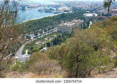 MALAGA, ANDALUCIA, SPAIN - AUGUST 11, 2018: View of Malaga's town hall, Port of Malaga and Pedro Luis Alonso garden from Mount Gibralfaro.