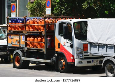 Malaga, Andalusia / Spain - August 23 2019. Gas cylinder transport truck parked in the city.