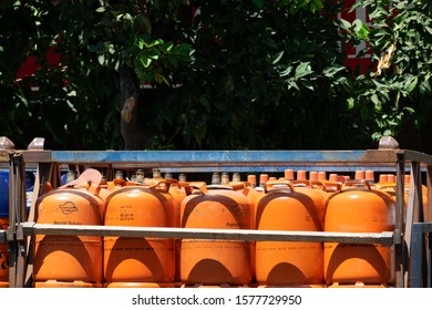 Malaga, Andalusia / Spain - August 23 2019. Details of gas cylinder transport truck parked in the city.