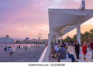 Malaga, Andalusia, Spain - August 28th 2018: The port of Malaga 'Muelle Uno' by pink sunset on a summer night.