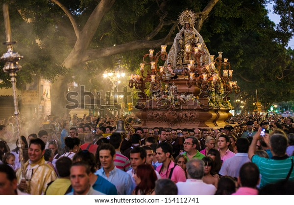 MALAGA -JULY 17: Unidentified locals carry holy statues on shoulders during the Virgen del Carmen festival on July 17, 2011 in Malaga (Spain) The 'Virgen del Carmen' is the patron saint  of fishermen