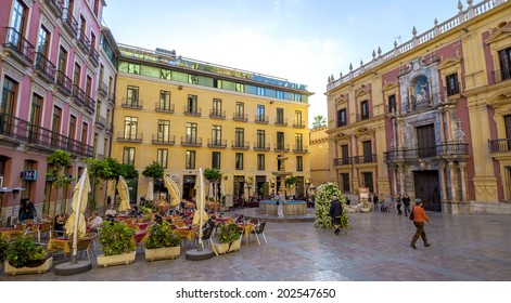 MALAGA - JUNE 12: City street view with cafeteria terraces and shops on June 12, 2013 in Malaga, Spain.