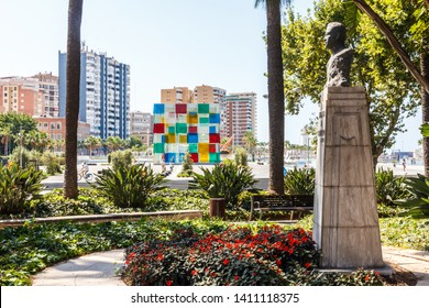 Malaga, Spain - 26th August 2015: Statue of  Ruben Dario in Malaga Park, The Pompidou cultural centre is in the background.
