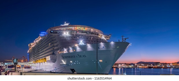 "Malaga, Spain. 27 th of March 2018. ""Symphony of the seas"" the biggest cruise ship built in the port of Malaga at night"
