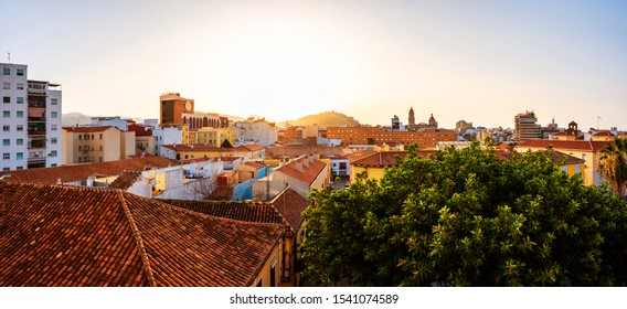 Malaga, Spain. Aerial view of the city center at sunrise with colorful clear sky in Malaga, Spain. City skyline with popular landmarks
