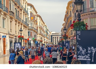 Malaga, Spain - April 21, 2018. People on the red carpet at the Marques de Larios street from anual film festival Cine en Espanol, Malaga, Spain