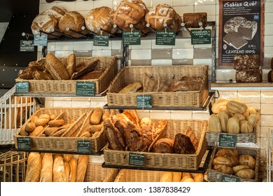 Malaga, Spain - August 04, 2018. Variety of fresh baked bread in bakery shop in Malaga city, Spain
