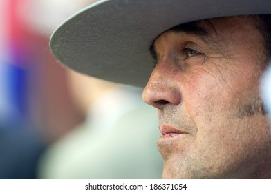 MALAGA, SPAIN - AUGUST, 14: A man with typical hat from Andalusia watching people dancing flamenco at the Malaga's August Fair on August, 14, 2009 in Malaga, Spain