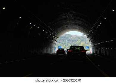 Malaga, Spain - August 24, 2021: Driver point of view personal perspective point of view in front of the cars driving through the tunnel. AP7 motorway