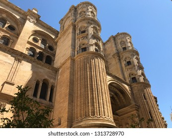 Malaga, Spain - August 9, 2018: View of the Cathedral of the Encarnacion located in front of the Plaza del Obispo.Monument Renaissance and declared as Cultural Property