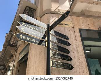 Malaga, Spain - August 9, 2018: View of an information post with several arrows that point to places in the center of the city of Malaga