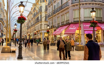 Malaga, Spain. Circa January 2016. Tourists walk along pedestrian Larios Street decorated for Christmas in downtown Malaga, Southern Spain.