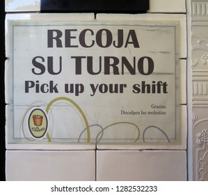 Malaga, Spain - December 12, 2018: Badly translated shop notice in Andalusian town