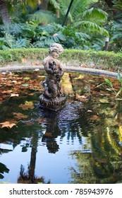 MALAGA, SPAIN - DECEMBER 19, 2017: Sculpture in a pond in Jardin de la Concepcion on December 19, 2017 in Malaga, Spain