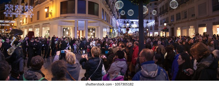 Malaga, Spain - December 28, 2013: Calle Marques Larios in Malaga decorated with christmas lights. Artists and musicians entertain the attracted crowds