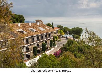 Malaga, Spain - December 7, 2016:  Hotel Parador de Malaga Gibralfaro from Castillo de Gibralfaro before the rain, Malaga, Costa del Sol, Andalusia, Spain, Europe.