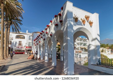 """Malaga, Spain - December 8, 2018: Young street musicians playing music on the street in """"Balcon de Europa"""" in Nerja, Malaga, Andalusia, Spain"""