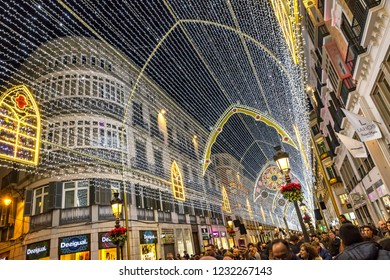 MALAGA, SPAIN - DECEMBER 9, 2017: Details of Christmas decorations on Calle Marques de Larios street in the centre of Malaga city, Andalusia, Spain. Most popular pedestrian street of Malaga