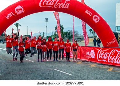 Malaga, Spain - February 18, 2018. Holi Run, the volunteer group from CocaCola