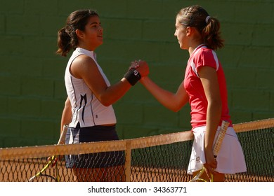 MALAGA, SPAIN – JAN 11 : Maria Jose Luque (L) and  Silvia Fuentes (R)  after the final match of the 1st round of the Nike Junior Tennis Tour tournament at Malaga Tennis Club January 11, 2009 in Malaga