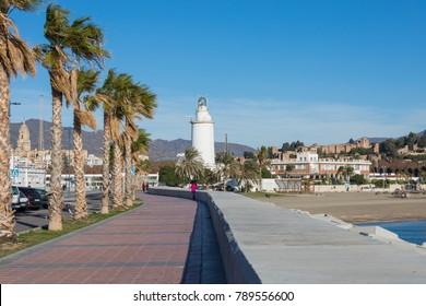 """MALAGA, SPAIN - JANUARY 02, 2018: Lighthouse """"La Farola de Malaga"""" in Malaga, Spain"""