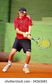 MALAGA, SPAIN – JANUARY 11 : Albert Alcaraz in action during the final match of the 1st round of the Nike Junior Tennis Tour tournament at Malaga Tennis Club January 11, 2009 in Malaga, Spain.
