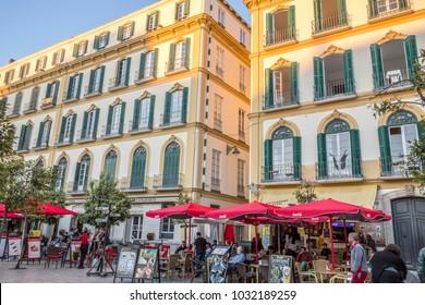 MALAGA, SPAIN- JANUARY 22,2018: Terrace bar at sunset, historic center street, square, plaza merced.Malaga, Spain.