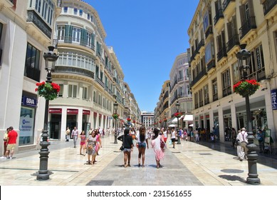 MALAGA, SPAIN - JULY 1, 2014: The main pedestrian and shopping area at the beginning of summer, on the first day of summer sales, which has attracted a large number of both locals and tourists.